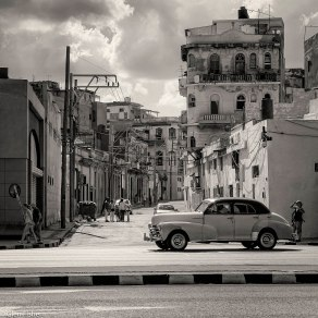 Malecon, side street and car